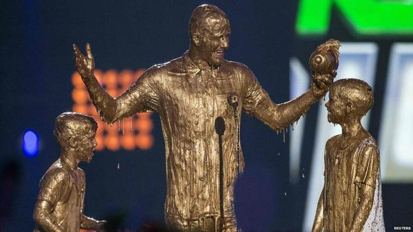 david beckham and his sons were drenched with gold slime