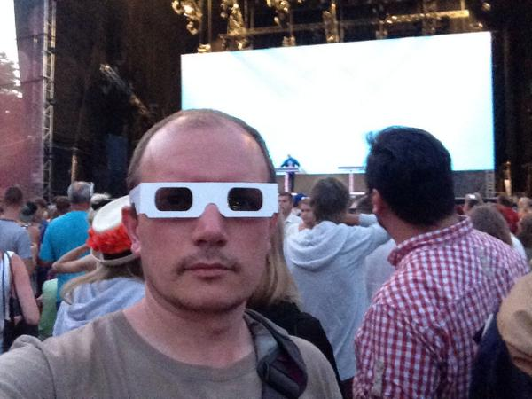 T minus 30 minutes for #Kraftwerk. We're being given 3D glasses to watch four men stand behind laptops. #Positivus http://t.co/Fxc967LhwY
