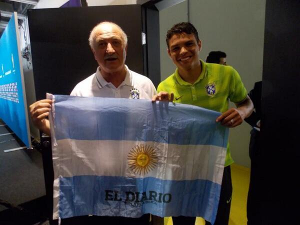 Brazils Luis Felipe Scolari and Thiago Silva pose with an Argentina flag because its lucky [El Dario]
