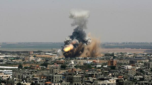 Israel's massive bombing campaign kills at least 15 Palestinians. http://t.co/5lwgJQOcJg http://t.co/tjjXFYwtaT #GazaUnderAttack