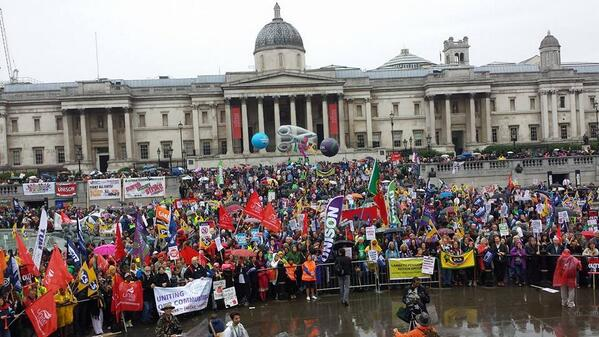 Rain not dampening spirits at #j10 rally in Trafalgar Square. http://t.co/loY9A5MQKd
