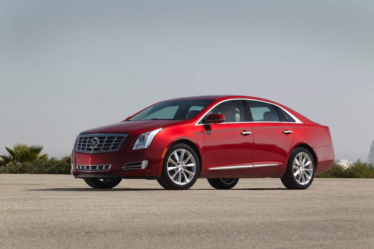 The cherry on top. Meet the irresistible 2014 #XTS. http://t.co/WnBsUEiApj