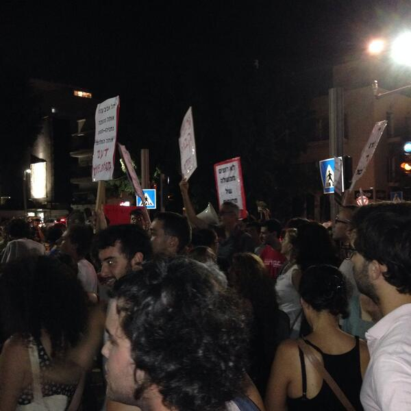 """The people demand: hold the fire"", Tel Aviv rally, approx 500 ppl http://t.co/FagkyuhH3M"