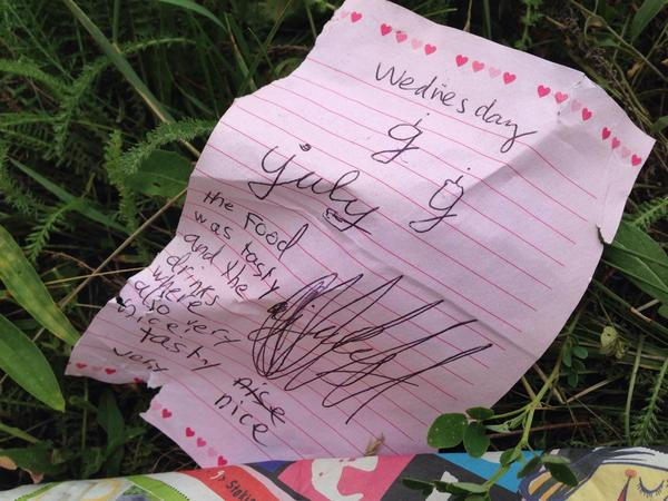 Child's note from MH17 'food was tasty , drinks also very nice' next to a girls pink rolling bag. #cbcnews #ukraine http://t.co/I7qq25MLj4