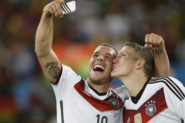 Arsenals Lukas Podolski celebrates Germany World Cup triumph with a Selfie