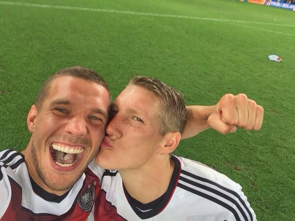Basti gives Poldi a kiss