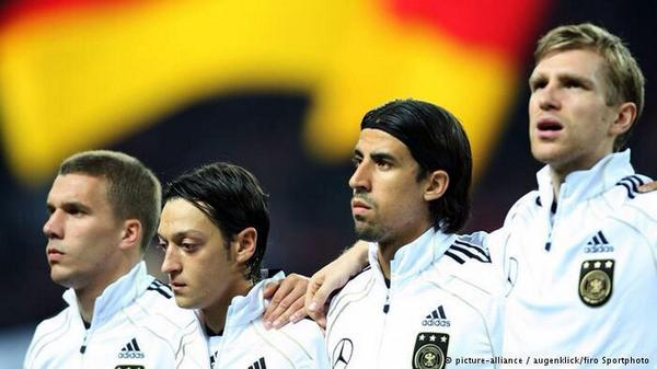 Lukas Podolski shouts Arsenal when Sami Khedira is asked who he will play for next season
