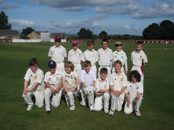 Tom representing the league team. Back row three from the left.