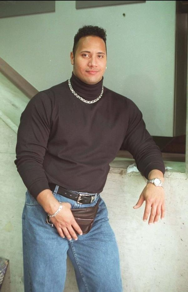 We're struggling to choose the best thing about this pic of The Rock in the 90s... http://t.co/n2GuLvNqY7 #90sRock http://t.co/FB19lnrOV5