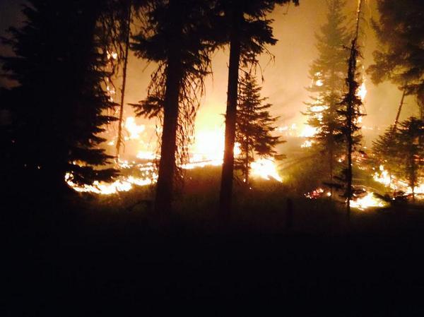 Ash starts to rain on wildfire-hit communities