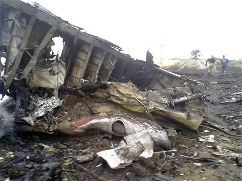 Horrific images MT @nycjim: Malaysian Airlines #MH17 crash scene in #Ukraine. @reuters: http://t.co/1FtByMV67v http://t.co/0YH428tRcL