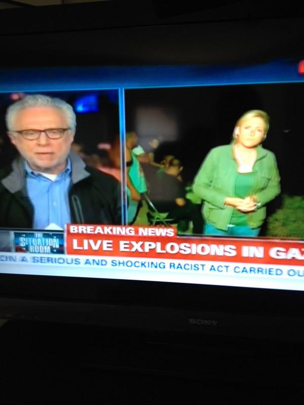 A macabre scene on CNN live coverage of Israeli crowd on hill doing cheers and chants watching bombardment of Gaza. http://t.co/SiAtDhCH2Y