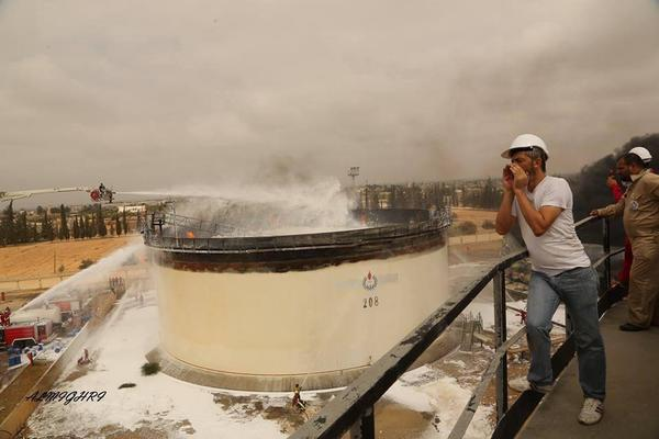 Brave firefighters of #Tripoli have finally gotten the 2 fuel tank fires under control. #Libya http://t.co/NnowsVMNOB