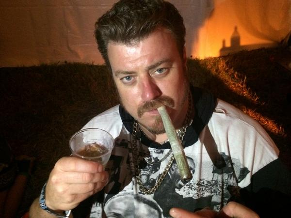 Robb Wells smoking a cigarette (or weed)
