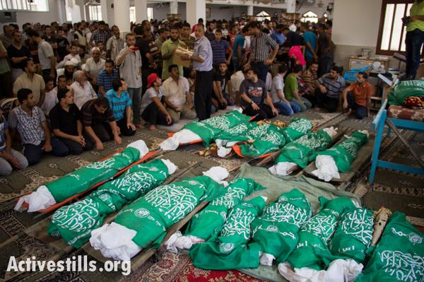 PHOTOS: A #Gaza funeral for 24 members of one family http://t.co/CUdDaCxoxs by @activestills http://t.co/cHxR9BRAL5