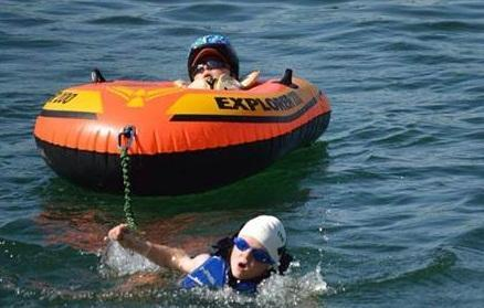 8-year-old boy finishes triathlon with his disabled brother http://t.co/4rp5AJ7N6v http://t.co/K6631ADd39