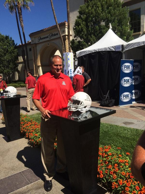 Coach Rodriguez and the white helmet. It's just for show, won't be worn. Just to clarify for you all. http://t.co/jogzaX0lee