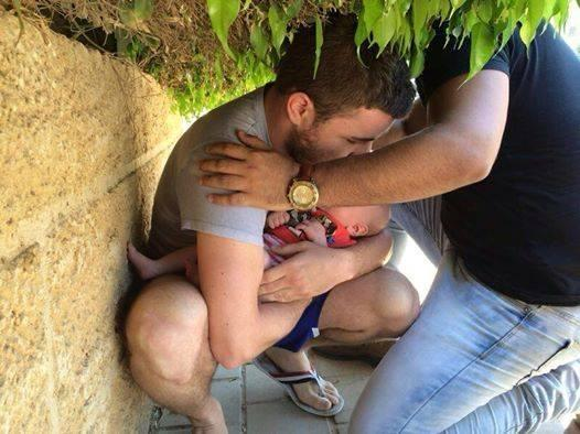 A stranger shields a father & his son as Beersheba, Israel, comes under rocket attack. NO NATION WOULD TOLERATE THIS