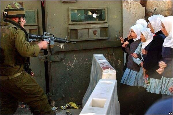 What kind of coward points a firearm at unarmed girls?? If you guessed Israeli soldiers, then your right! #Gaza http://t.co/dqaEwqeDPg