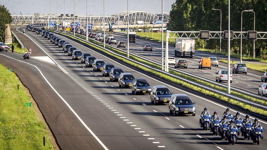RT @AntonyLoveless: This pic via @StigAbell of the dead from #MH17 arriving in the Netherlands is hauntingly beautiful and tragically sad h…