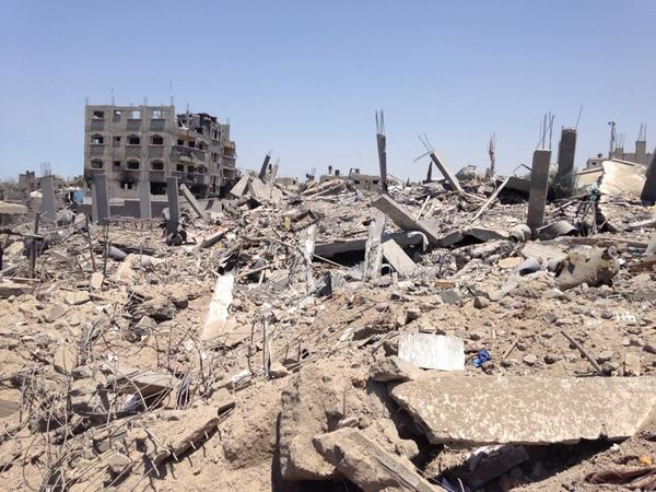 Blocks of apartments houses just gone in Shijaiyah. Gaza is just stunned. http://t.co/0FZg0emsnP