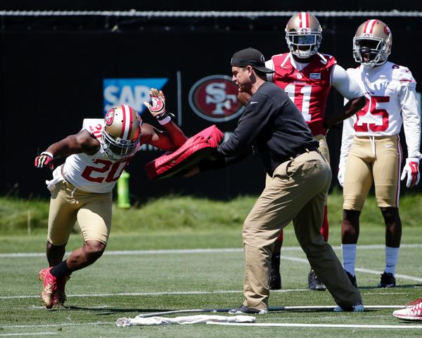 90+ and he's wearing pants and a sweatshirt. MT @KariVanHorn: Jim Harbaugh running a drill. (Photo cred: AP) http://t.co/iuR9iRLnJa