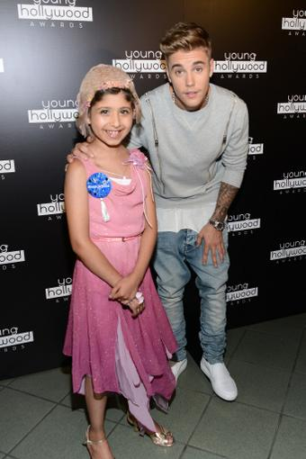 Justin Bieber grants young girl's wish, takes her as his date to awards show http://t.co/QD2NlUFslF #YHA http://t.co/bswEpWi1aW