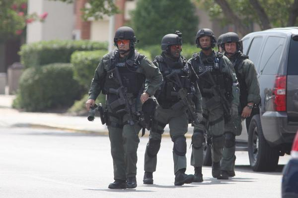 Police units leaving Northwoods Mall. Here's pic of sheriff's SWAT team after finishing search. #chs #chsnews http://t.co/DhUhWAhEg8