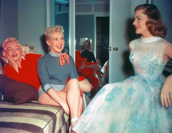 Photos: Lauren Bacall, Marilyn Monroe and Betty Grable between takes on the set of How to Marry a Millionaire (1953) http://t.co/RfotZKkAT9