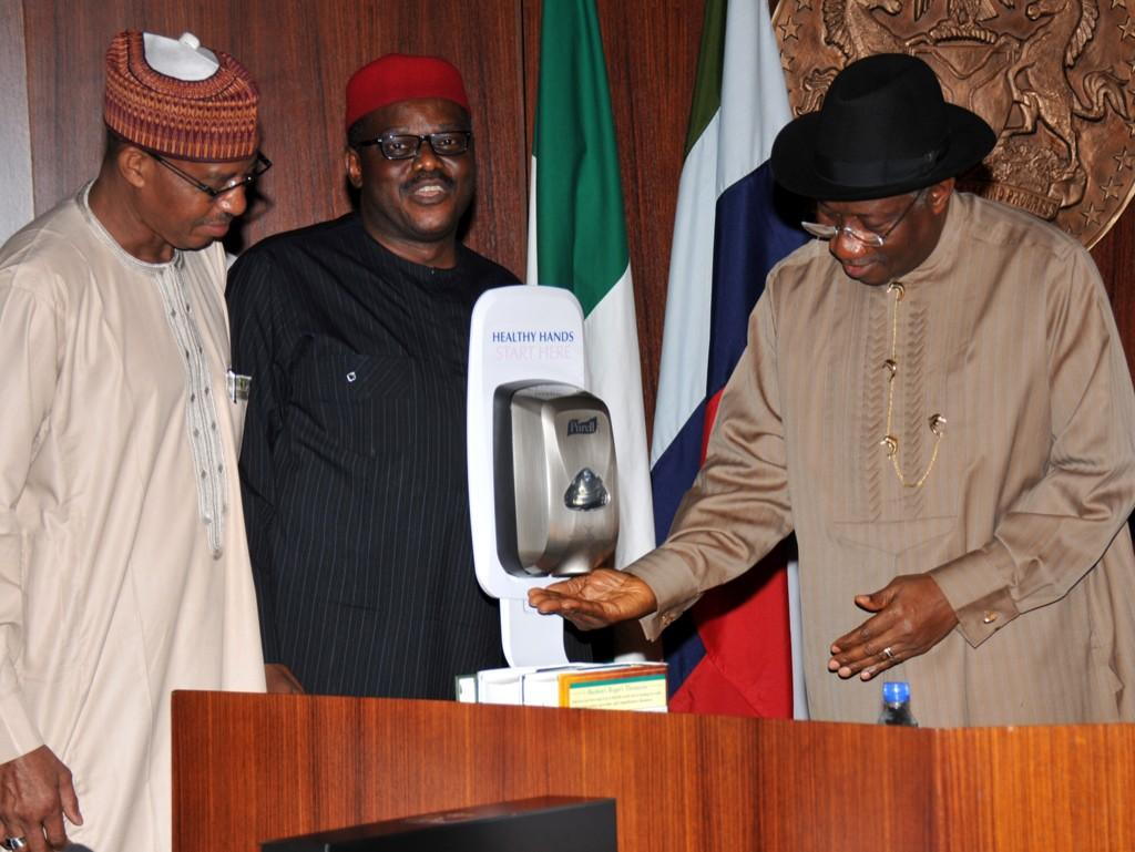 President Jonathan using hand sanitizer during on-going meeting on Ebola Virus with state governors at the Villa.