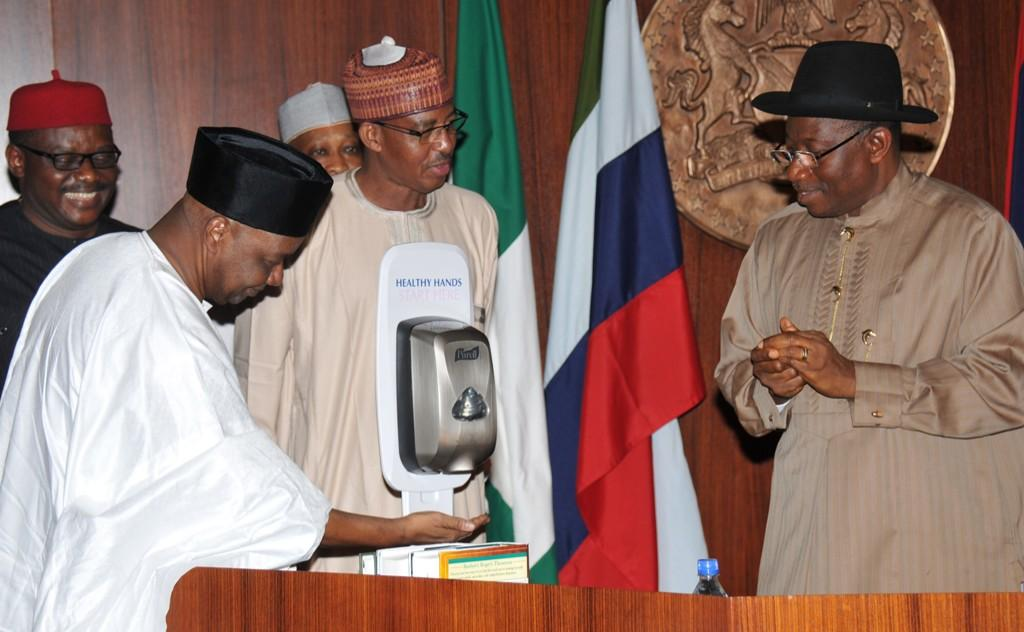 VP Namadi Sambo using hand sanitizer during on-going meeting with state governors on Ebola Virus at the Villa.