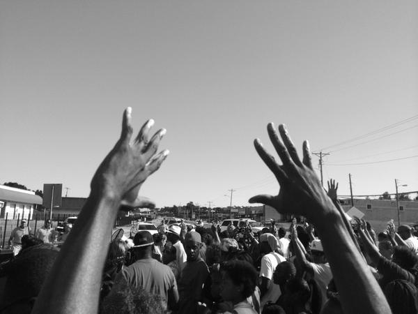 """Chants of """"Hands up, Don't Shoot!"""" At march and rally not far from scene of Michael Brown killing. http://t.co/zi9aC39ys6"""
