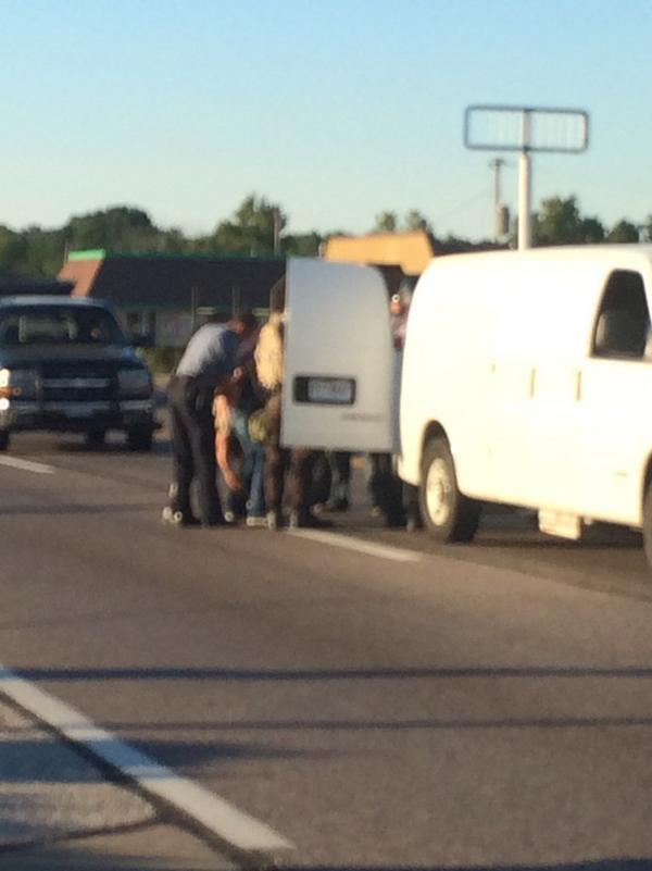 Photo of reporter I believe to be @ryanjreilly being cuffed and put in a police van minutes ago in #Ferguson http://t.co/l6olRUPk13