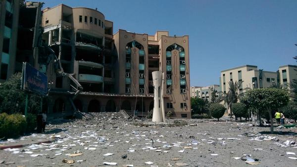 Taken earlier today the bombed out Islamic University in #Gaza - ground was covered in English Literature exam papers http://t.co/cUQn57TJpy