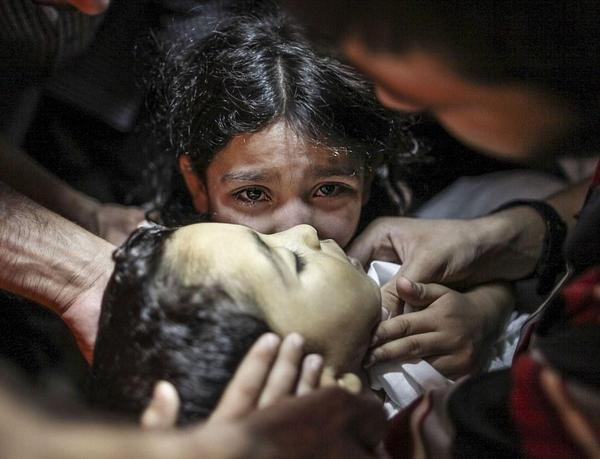 Your eyes, girl, your eyes. They carry the pain of the whole world. I will remember them as long as I live. #Gaza http://t.co/7v5s9c3CzO