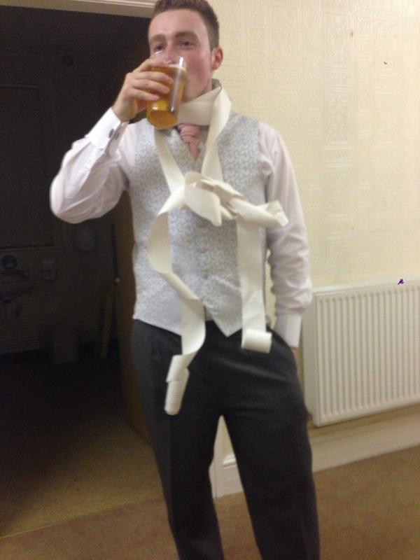 My mate got married last night, so proud of him, here he is wearing the receipt from the bar http://t.co/Sa5JiZwRC3