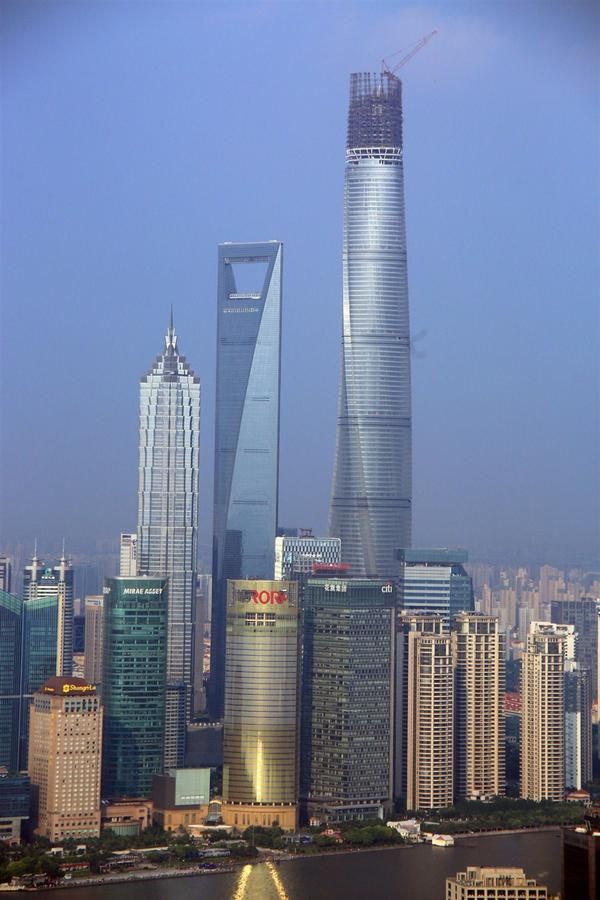 Shanghai Tower reached its full height of 632 meters yesterday. http://t.co/aZ8kjwtHzU http://t.co/DAoc2eLo5a