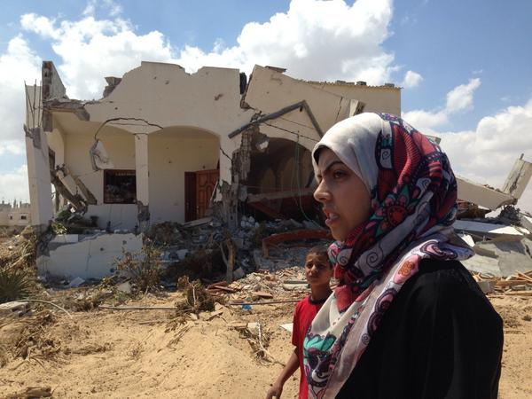 Lamia Al Shaami at ruins of her family house in Zanneh -used by Israeli soldiers as base and destroyed when they left http://t.co/a8CcIYzIjS