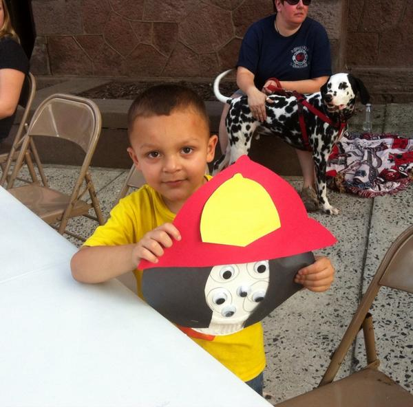 Ethan Caballero, 4, says his Dalmatian looks almost the same as Maverick, in the background @ 1st Methodist. #mercnno http://t.co/crPDYqXQiO