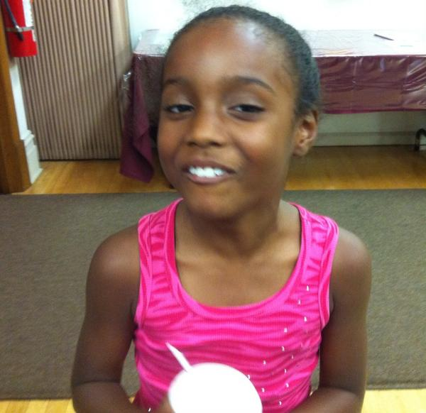 Tahj Phillips, 7, enjoys her water ice at First Methodist. #mercnno http://t.co/Nd4X7iPdod
