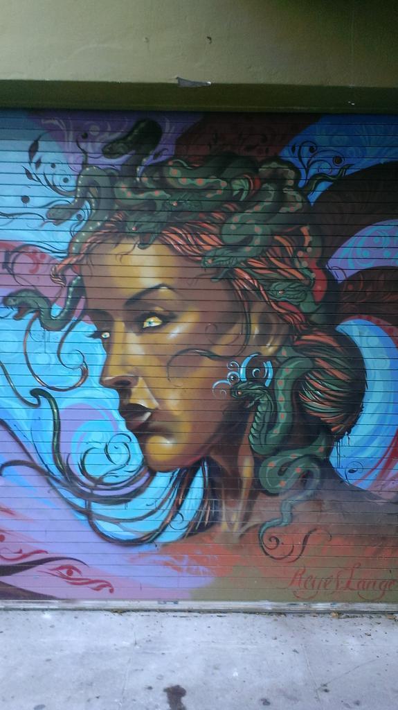 Gotta love street art. Serpentine mistress: http://t.co/BF7b7ylh96