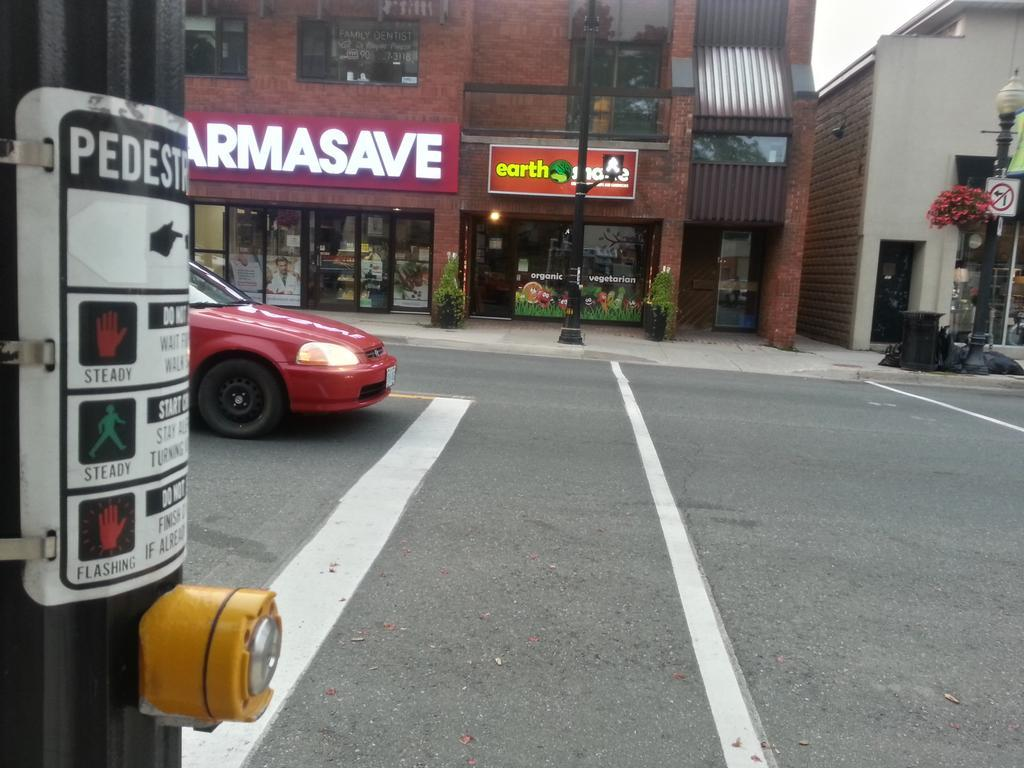 Button-activated crosswalk on King Street West at Foundry Street