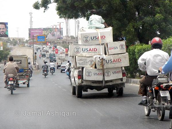 where are these cartons going, so brutally staked in this vahicle without a number plate ? #karachi http://t.co/tT92KKZww4