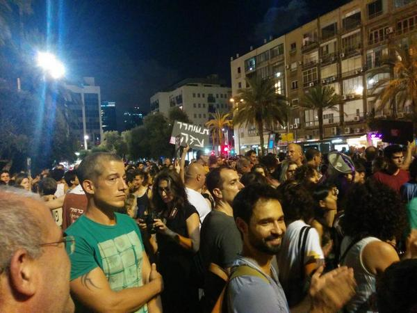 """Free Gaza"" sign in Tel Aviv. We are chanting ""A racist government is a security threat"" http://t.co/SSTQl7Kk3T"