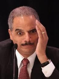 Eric Holder tells students in Ferguson he's a victim of racial profiling.