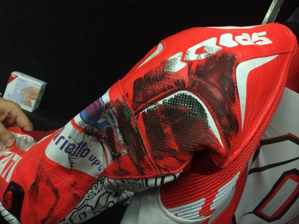 """Andrea Dovizioso's leathers, after a little """"rubbing is racing"""" with Valentino Rossi. #MotoGP #IndyGP #Ducati #Spidi http://t.co/Ic28MzIgyi"""