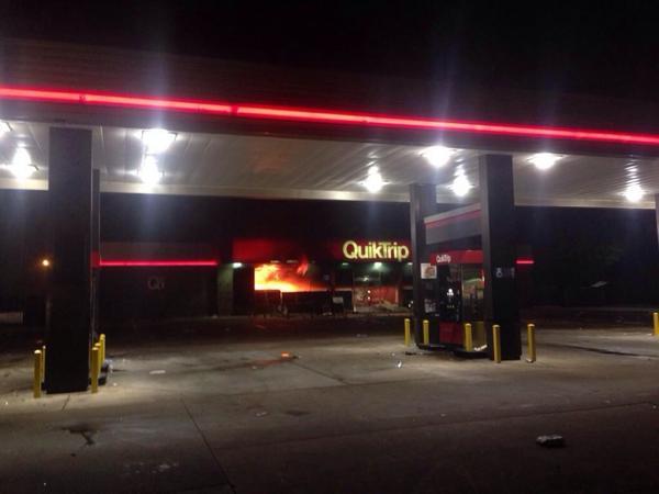 "THE GAS STATION ON FIRE YIKES ""@MichaelSkolnik: The QuickTrip is now burning. #Ferguson (photo: @PDPJ) http://t.co/vAyrSgfzRM"""