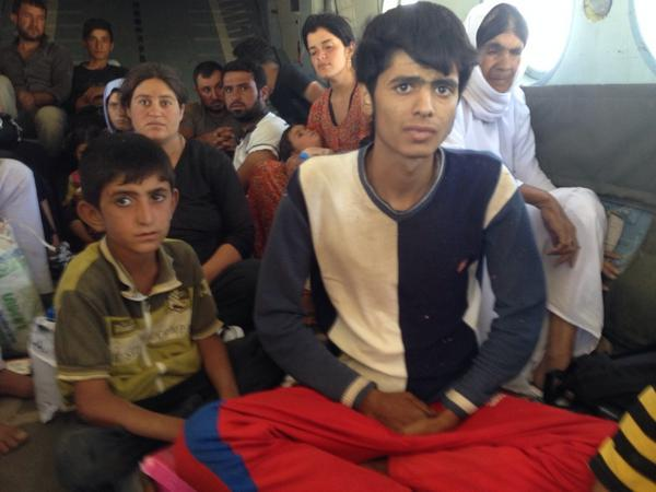 Desperate Yazidi refugees plucked from Mt Sinjar by Iraqi army helicopter: http://t.co/x4eBY1oaKD