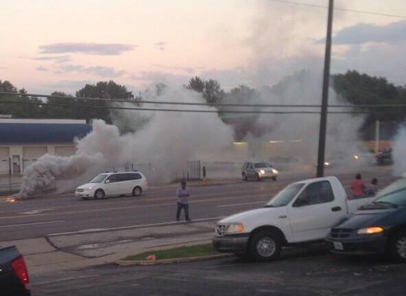That's me in the cloud of tear gas tweeting in #Ferguson. http://t.co/9fMCdRGQYX