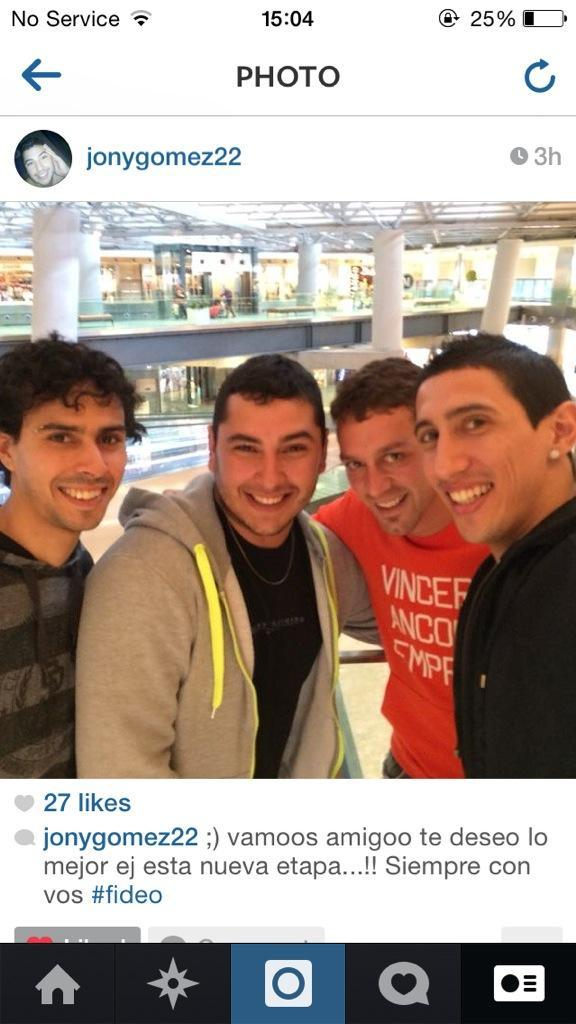 Bv5F5XJCYAAl9df Angel Di Maria is pictured with fans at Madrid airport en route to Manchester United [Instagram]